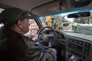 Bob Ackley is stopped as contractors work on route 9 on repairs to a gas line underground. (Jesse Costa/WBUR)